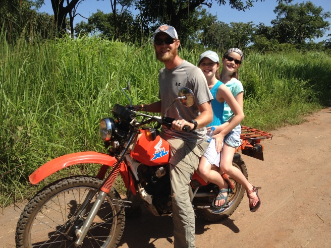 Chase taking the twins for a Boda Boda ride.